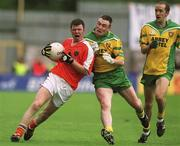 7  July 2002; Ronan Clarke, Armagh, in action   against Donegal's John Gildea, centre and Paul McGonigle, right. Armagh v Donegal, Ulster Football Final, St Tighearnachs Park, Clones, Co. Monaghan. Picture credit; Damien Eagers / SPORTSFILE