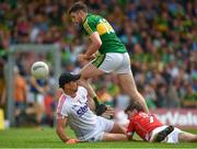 2 July 2017; Paul Geaney of Kerry scores his side's only goal despite the best efforts of Cork goalkeeper Ken O'Halloran and Kevin Crowley during the Munster GAA Football Senior Championship Final match between Kerry and Cork at Fitzgerald Stadium in Killarney, Co Kerry. Photo by Brendan Moran/Sportsfile