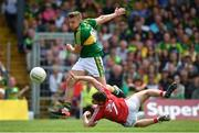 2 July 2017; James O'Donoghue of Kerry attempts a shot on goal despite the best efforts of Kevin Crowley of Cork during the Munster GAA Football Senior Championship Final match between Kerry and Cork at Fitzgerald Stadium in Killarney, Co Kerry. Photo by Brendan Moran/Sportsfile