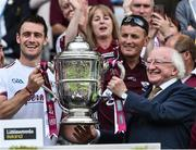 2 July 2017; Captain of Galway David Burke lifts the The Bob O'Keeffe Cup with President Michael D Higgins at the end of the Leinster GAA Hurling Senior Championship Final match between Galway and Wexford at Croke Park in Dublin. Photo by David Maher/Sportsfile