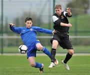 28 February 2012; James Boland, Drogheda Institute of FE, in action against Nick Foster, IT Carlow 'C'. Umbro CUFL Division Two Final, Drogheda Institute of FE v IT Carlow 'C', Greenogue, Peamount United FC, Peamount, Dublin. Picture credit: Barry Cregg / SPORTSFILE