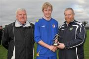 28 February 2012; Cormac Renaghan, IT Drogheda Institute of FE, is presented with the Man of the Match award by IUFU Chairman Terry McAuley, left, and CFAI Chairman Padraig Carney, right, after the game. Umbro CUFL Division Two Final, Drogheda Institute of FE v IT Carlow 'C', Greenogue, Peamount United FC, Peamount, Dublin. Picture credit: Barry Cregg / SPORTSFILE