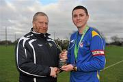 28 February 2012; IT Drogheda Institute of FE captain Garreth Toal is presented with the Division 2 cup by CFAI Chairman Padraig Carney after the game. Umbro CUFL Division Two Final, Drogheda Institute of FE v IT Carlow 'C', Greenogue, Peamount United FC, Peamount, Dublin. Picture credit: Barry Cregg / SPORTSFILE