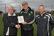 28 February 2012; Denis Cummins, Peamount Utd, receives a plaque from IUFU Chairman Terry McAuley, left, and CFAI Chairman Padraig Carney, right,for the use of their grounds for the game. Umbro CUFL Division Two Final, Drogheda Institute of FE v IT Carlow 'C', Greenogue, Peamount United FC, Peamount, Dublin. Picture credit: Barry Cregg / SPORTSFILE
