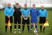 28 February 2012; IT Carlow 'C' captain Robbie Farrell, second left, and Drogheda Institute of FE captain Garreth Toal, second right, alongside referee Eddie Reilly, centre and linesmen Tommy Traynor, left, and Shay Travers, right. Umbro CUFL Division Two Final, Drogheda Institute of FE v IT Carlow 'C', Greenogue, Peamount United FC, Peamount, Dublin. Picture credit: Barry Cregg / SPORTSFILE
