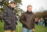 26 February 2012; Eamon Coghlan, Irish Sports Council, and his son John Coghlan, left, watch the Junior Men's race during the Woodie's DIY AAI Inter Club Cross Country Championships of Ireland 2012. Santry Demesne, Santry, Dublin. Picture credit: Pat Murphy / SPORTSFILE