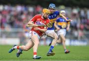 3 July 2017; Liam O'Shea of Cork in action against Michael Feehan of Tipperary during the Electric Ireland Munster GAA Hurling Minor Championship semi-final replay match between Cork and Tipperary at Páirc Uí Rinn, Cork. Photo by Eóin Noonan/Sportsfile