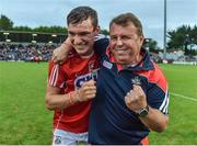 3 July 2017; Brian Turnbull of Cork celebrates with Cork manager Denis Ring after the Electric Ireland Munster GAA Hurling Minor Championship semi-final replay match between Cork and Tipperary at Páirc Uí Rinn, Cork. Photo by Eóin Noonan/Sportsfile