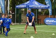 5 July 2017; Jamie Heaslip and Jamison Gibson-Park of Leinster Rugby came out to the Bank of Ireland Summer Camp to meet up with some local young rugby talent in Terenure College RFC. Pictured is Leinster's Jamison Gibson-Park with young Rian Flavin, from Terenure, Dublin. Terenure College RFC, Terenure, Dublin. Photo by Seb Daly/Sportsfile