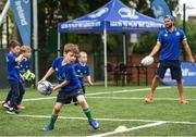 5 July 2017; Jamie Heaslip and Jamison Gibson-Park of Leinster Rugby came out to the Bank of Ireland Summer Camp to meet up with some local young rugby talent in Terenure College RFC. Pictured is Max Morton, from Terenure, Dublin, during a coaching exercise with Leinster's Jamison Gibson-Park. Terenure College RFC, Terenure, Dublin. Photo by Seb Daly/Sportsfile