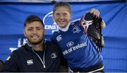 5 July 2017; Rob Kearney and Ross Byrne of Leinster Rugby came out to the Bank of Ireland Leinster Rugby Summer Camp at Donnybrook Stadium. Pictured is Kyla Fitzpatrick, age 10, after having her big brother's spikes signed by Ross Byrne, pictured, and Kearney at Donnybrook Stadium in Dublin. Photo by Cody Glenn/Sportsfile