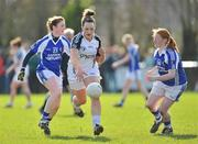 4 March 2012; Siobhan Hurley, Kildare, in action against Laura Hyland, left, and Clodagh Dunne, Laois. Bord Gais Energy Ladies National Football League, Division 1, Round 4, Kildare v Laois, Ballykelly, Co. Kildare. Picture credit: Barry Cregg / SPORTSFILE