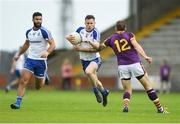 8 July 2017; Karl O'Connell of Monaghan in action against Adrian Flynn of Wexford during the GAA Football All-Ireland Senior Championship Round 2B match between Wexford and Monaghan at Innovate Wexford Park in Co Wexford. Photo by Eóin Noonan/Sportsfile