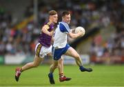 8 July 2017; Karl O'Connell of Monaghan in action against Jake Firman of Wexford during the GAA Football All-Ireland Senior Championship Round 2B match between Wexford and Monaghan at Innovate Wexford Park in Co Wexford. Photo by Eóin Noonan/Sportsfile