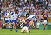 8 July 2017; Kevin O'Grady of Wexford in action against Neil McAdam, left, and Kieran Hughes of Monaghan during the GAA Football All-Ireland Senior Championship Round 2B match between Wexford and Monaghan at Innovate Wexford Park in Co Wexford. Photo by Eóin Noonan/Sportsfile