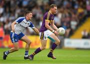 8 July 2017; Kevin O'Grady of Wexford in action against Ryan Wylie of Monaghan during the GAA Football All-Ireland Senior Championship Round 2B match between Wexford and Monaghan at Innovate Wexford Park in Co Wexford. Photo by Eóin Noonan/Sportsfile