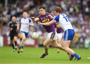 8 July 2017; John Tubritt of Wexford in action against Kieran Duffy of Monaghan during the GAA Football All-Ireland Senior Championship Round 2B match between Wexford and Monaghan at Innovate Wexford Park in Co Wexford. Photo by Eóin Noonan/Sportsfile