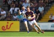 8 July 2017; PJ Banville of Wexford in action against Owen Duffy of Monaghan during the GAA Football All-Ireland Senior Championship Round 2B match between Wexford and Monaghan at Innovate Wexford Park in Co Wexford. Photo by Eóin Noonan/Sportsfile