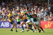8 July 2017; Cian O'Dea of Clare in action against Cillian O'Connor, left, and Conor Loftus of Mayo during the GAA Football All-Ireland Senior Championship Round 3A match between Clare and Mayo at Cusack Park in Ennis, Co Clare. Photo by Diarmuid Greene/Sportsfile