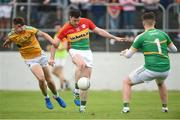 8 July 2017; John Murphy of Carlow in action against Conor Cullen, left, and Brendan Flynn, right, of Leitrim during the GAA Football All-Ireland Senior Championship Round 2B match between Carlow and Leitrim at Netwatch Cullen Park in Co Carlow. Photo by Barry Cregg/Sportsfile