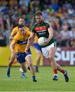 8 July 2017; Aidan O'Shea of Mayo in action against Eoghan Collins of Clare during the GAA Football All-Ireland Senior Championship Round 3A match between Clare and Mayo at Cusack Park in Ennis, Co Clare. Photo by Diarmuid Greene/Sportsfile
