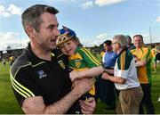 8 July 2017; Donegal manager Rory Gallagher celebrates with his son Seanie, age 3, at the end of the GAA Football All-Ireland Senior Championship Round 3A match between Meath and Donegal at Páirc Tailteann in Navan, Co Meath. Photo by David Maher/Sportsfile