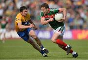 8 July 2017; Andy Moran of Mayo in action against Gordon Kelly of Clare during the GAA Football All-Ireland Senior Championship Round 3A match between Clare and Mayo at Cusack Park in Ennis, Co Clare. Photo by Diarmuid Greene/Sportsfile