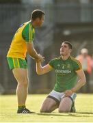 8 July 2017; A dejected Bryan Menton of Meath as Neil McGee of Donegal helps him to his feet at the end of the GAA Football All-Ireland Senior Championship Round 3A match between Meath and Donegal at Páirc Tailteann in Navan, Co Meath. Photo by David Maher/Sportsfile