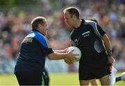 8 July 2017; Clare manager Colm Collins jokingly tussles for possession with linesman James Bermingham at half time in the GAA Football All-Ireland Senior Championship Round 3A match between Clare and Mayo at Cusack Park in Ennis, Co Clare. Photo by Diarmuid Greene/Sportsfile