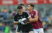9 July 2017; Ben Tuohy of Sligo is tackled by Sean Fitzgerald of Galway during the Electric Ireland Connacht GAA Football Minor Championship Final between Galway and  Sligo at Pearse Stadium in Galway. Photo by Ramsey Cardy/Sportsfile