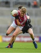 9 July 2017; Conor Campbell of Galway is tackled by Roland Anderson of Sligo during the Electric Ireland Connacht GAA Football Minor Championship Final between Galway and Sligo at Pearse Stadium in Galway. Photo by Ramsey Cardy/Sportsfile