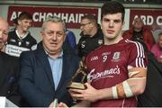 9 July 2017; Pictured is Kevin Molloy, Customer Relationship Manager at Electric Ireland, proud sponsor of the Electric Ireland GAA All-Ireland Minor Championships, presenting Evan Murphy of Galway with the Player of the Match award for his outstanding performance in the Electric Ireland Connacht Minor Football Championship Final. Throughout the Championships fans can follow the conversation, support the Minors and be a part of something major through the hashtag #GAAThisIsMajor. Photo by David Maher/Sportsfile