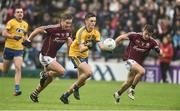 9 July 2017; Brian Stack of Roscommon on his way to scoring his sides second goal from Gary O'Donnell and Eoghan Kerin of Galway during the Connacht GAA Football Senior Championship Final match between Galway and Roscommon at Pearse Stadium in Salthill, Galway. Photo by David Maher/Sportsfile