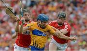 9 July 2017; Shane O'Donnell of Clare is fouled for a penalty by Mark Coleman, left, and Damien Cahalane of Cork during the Munster GAA Hurling Senior Championship Final match between Clare and Cork at Semple Stadium in Thurles, Co Tipperary. Photo by Piaras Ó Mídheach/Sportsfile