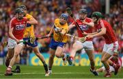 9 July 2017; Shane O'Donnell of Clare passes under pressure from Cork players Darragh Fitzgibbon, 9, Damian Cahalane, 3, and Mark Coleman during the Munster GAA Hurling Senior Championship Final match between Clare and Cork at Semple Stadium in Thurles, Co Tipperary. Photo by Ray McManus/Sportsfile