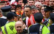 9 July 2017; Cork captain Stephen McDonnell makes his way through supporters and the Garda cordon to make his way to collect the cup after the Munster GAA Hurling Senior Championship Final match between Clare and Cork at Semple Stadium in Thurles, Co Tipperary. Photo by Ray McManus/Sportsfile