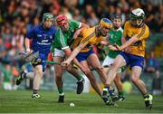 12 July 2017; Barry Nash of Limerick in action against Dara Walsh and Conor O'Halloran, right, of Clare during the Bord Gais Energy Munster GAA Hurling Under 21 Championship Semi-Final match between Limerick and Clare at the Gaelic Grounds in Limerick. Photo by Brendan Moran/Sportsfile