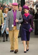 14 March 2012; A couple wearing matching outfits in attendance during Ladies Day at the Cheltenham Festival. Cheltenham Racing Festival, Prestbury Park, Cheltenham, England. Picture credit: Brendan Moran / SPORTSFILE