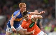 15 July 2017; Niall Grimley of Armagh in action against George Hannigan of Tipperary during the GAA Football All-Ireland Senior Championship Round 3B match between Tipperary and Armagh at Semple Stadium in Thurles, Co Tipperary. Photo by Ray McManus/Sportsfile