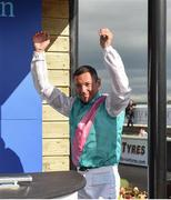15 July 2017; Frankie Dettori celebrates on the way up to collecting his prize after winning the Darley Irish Oaks during Day 1 of the Darley Irish Oaks Weekend at the Curragh in Kildare. Photo by Eóin Noonan/Sportsfile