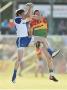 15 July 2017; Darren Hughes of Monaghan in action against Darragh Foley of Carlow during the GAA Football All-Ireland Senior Championship Round 3B match between Carlow and Monaghan at Netwatch Cullen Park in Carlow. Photo by David Maher/Sportsfile