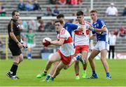 16 July 2017; Padraig McGrogan of Derry  in action against James Smith of Cavan  during the Electric Ireland Ulster GAA Football Minor Championship Final match between Cavan and Derry at St Tiernach's Park in Clones, Co. Monaghan. Photo by Oliver McVeigh/Sportsfile