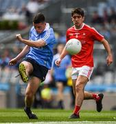 16 July 2017; Ross McGarry of Dublin kicks a point under pressure fron Eoghan Callaghan of Louth during the Electric Ireland Leinster GAA Football Minor Championship Final match between Dublin and Louth at Croke Park in Dublin. Photo by Ray McManus/Sportsfile