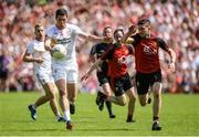 16 July 2017; Sean Cavanagh of Tyrone  in action against Niall McParland of Down during the Ulster GAA Football Senior Championship Final match between Tyrone and Down at St Tiernach's Park in Clones, Co. Monaghan. Photo by Oliver McVeigh/Sportsfile