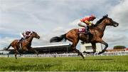 16 July 2017; Elizabeth Browning, with Seamie Heffernan up, cross the line to win the Kilboy Estate Stakes ahead of Wilamina, with Colm O'Donoghue up, who finished second, during Day 2 of the Darley Irish Oaks Weekend at the Curragh in Kildare. Photo by Cody Glenn/Sportsfile