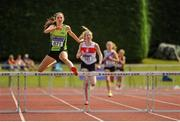 16 July 2017; Deirdre Murray, Na Fianna AC, Co.Meath, on her way to winning the Girl's Under18 400m Hurdles event, during the AAI Juvenile Championships Day 3 in Tullamore, Co Offaly. Photo by Tomás Greally/Sportsfile