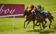 16 July 2017; Surrounding, right, with Shane Foley up, race alongside eventual second-place-finisher Stormy Belle, with Pat Smullen up, on their way to winning the Irish Stallion Farms EBF Fillies Handicap during Day 2 of the Darley Irish Oaks Weekend at the Curragh in Kildare. Photo by Cody Glenn/Sportsfile