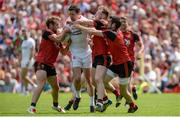 16 July 2017; Sean Cavanagh of Tyrone  in action against Darren O'Hagan, Gerard McGovern and Kevin McKernan of Down  during the Ulster GAA Football Senior Championship Final match between Tyrone and Down at St Tiernach's Park in Clones, Co. Monaghan. Photo by Oliver McVeigh/Sportsfile