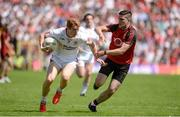 16 July 2017; Peter Harte of Tyrone  in action against Niall McParland of Down  during the Ulster GAA Football Senior Championship Final match between Tyrone and Down at St Tiernach's Park in Clones, Co. Monaghan. Photo by Oliver McVeigh/Sportsfile