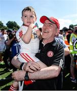 16 July 2017; Tyrone manager Mickey Harte with grand son Michael Harte junior after the Ulster GAA Football Senior Championship Final match between Tyrone and Down at St Tiernach's Park in Clones, Co. Monaghan. Photo by Oliver McVeigh/Sportsfile